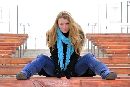 The young beautiful girl on a bench photo