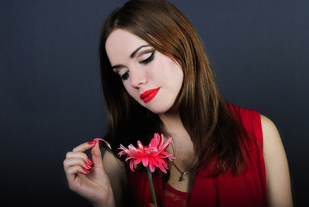 making look younger beautiful bright girl tears away sheet from flower Stock Photo - 12732025