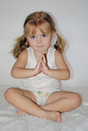 small beautiful girl concerns with yoga