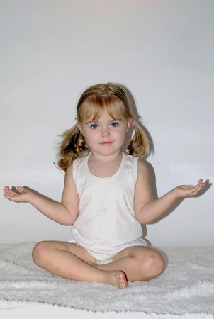 yoga pillows: small beautiful girl concerns with yoga