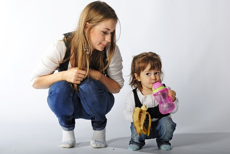 small beautiful girl with ma in in jeans and vest on white background Stock Photo - 13492844
