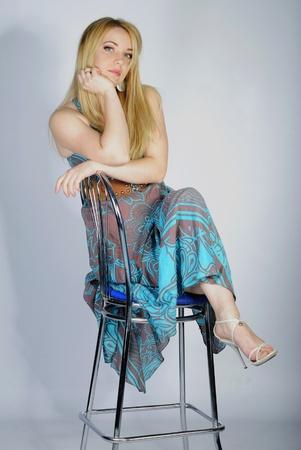 harming: beautiful girl blonde in year bright peasant womans dress in aspic