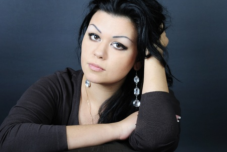 making look younger beautiful girl with black climbing hair photo