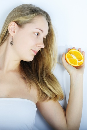 nacked: younger beautiful girl with citrus fruit