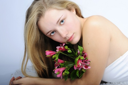 younger: younger beautiful girl blonde with flower