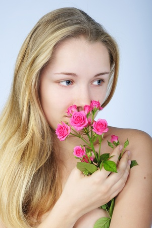 making look younger beautiful girl blonde with rose rose Stock Photo - 13559576