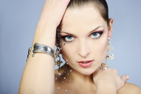 beautiful girl fashionable on white background with bright diamond photo