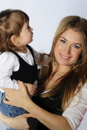 small beautiful girl with ma in in jeans and vest on white background Stock Photo - 13853328