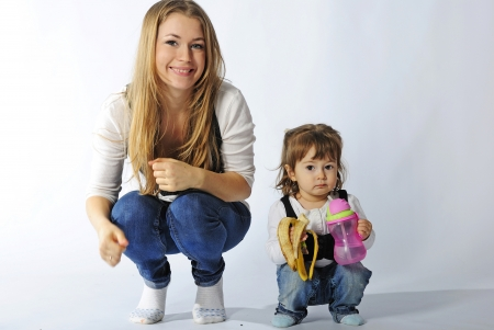 small beautiful girl with ma in in jeans and vest on white background Stock Photo - 13853312