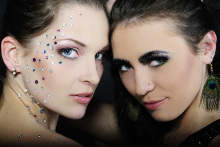 Two beautiful stylish fashionable girls to models with diamond and long lash on dark background Stock Photo - 13853364
