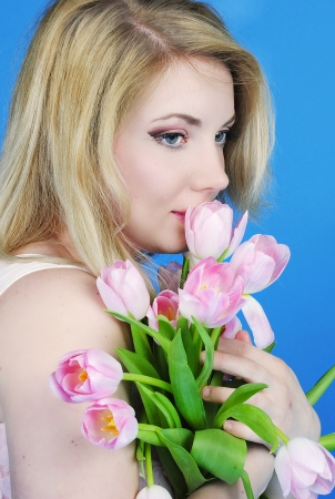 beautiful girl with rose tulip on blue background
