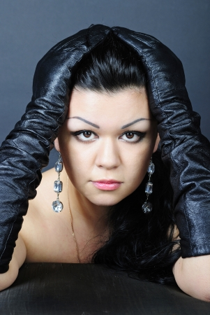 younger beautiful girl with black climbing hair in ������� glove photo