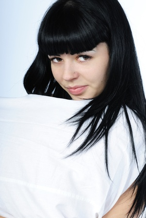cogitations: younger beautiful girl with black long hair in white bed