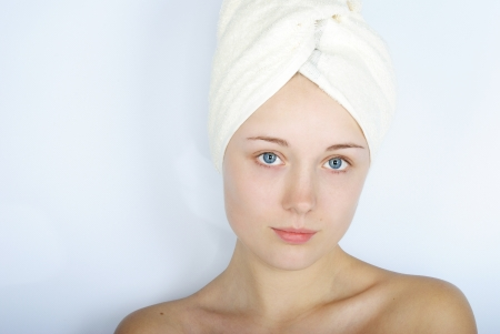 making look younger beautiful girl with blue eye with towel on head