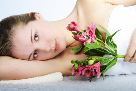 nacked: making look younger beautiful girl blonde with bright flower Stock Photo
