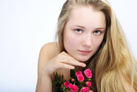 nacked: making look younger beautiful girl blonde with rose rose Stock Photo