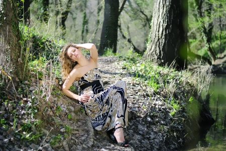 beautiful girl in green wood by summer Stock Photo - 14184467