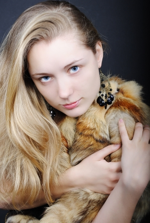 The beautiful girl against a dark background blue eyes photo