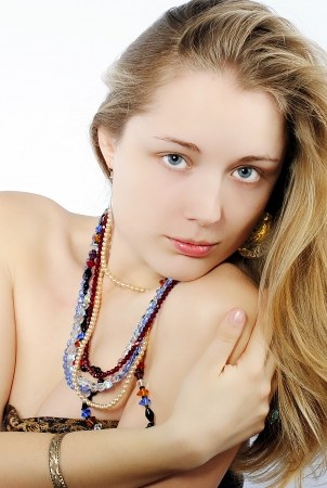 Portrait of the beautiful girl in costume jewellery  photo