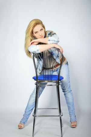 beautiful girl blonde with long hair in jeans suit  photo