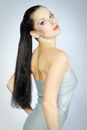 mooi meisje trendy op een witte achtergrond met heldere diamant Stockfoto - 14606302