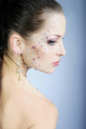 beautiful girl fashionable on white background with bright diamond