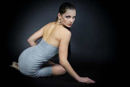 beautiful girl fashionable on dark background with bright diamond