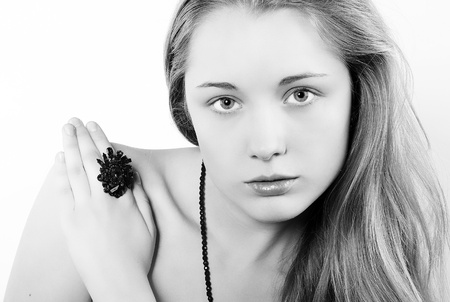 Portrait of the beautiful girl in costume jewellery