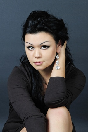 younger: younger beautiful girl with black climbing hair