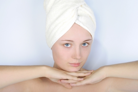 superimpose: making look younger beautiful girl with blue eye with towel on head