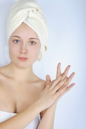 igrave: making look younger beautiful girl with blue eye with towel on head