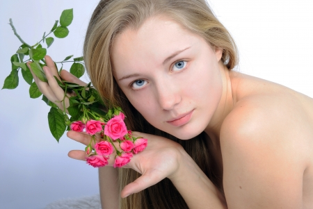 nacked: making look younger beautiful girl blonde with rose  Stock Photo