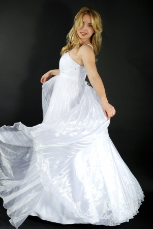 beautiful blonde in white gown on gray background Stock Photo - 14934047