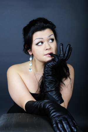 cogitations: younger beautiful girl with black climbing hair in black glove
