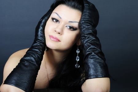 younger beautiful girl with black climbing hair in black glove Stock Photo - 16096623