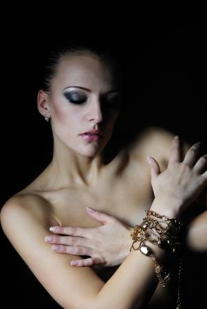 nacked: beautiful girl model with wet body on dark background