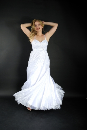 beautiful blonde in white gown on gray background Stock Photo - 19350298