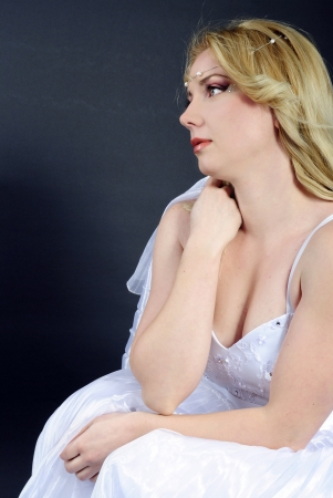 beautiful blonde in white gown on gray background Stock Photo - 19350302