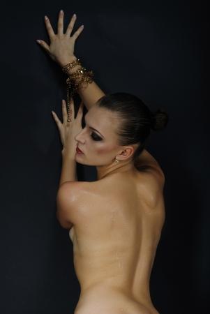 beautiful girl model with wet body on dark background  Stock Photo