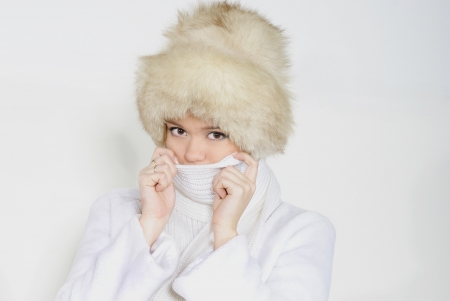 The young beautiful girl in fur on a white background photo