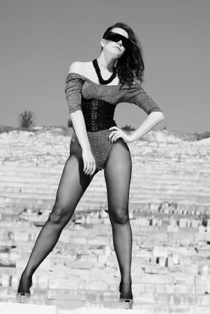 cogitation: beautiful girl on heel amongst stone captive
