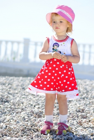 little girl playing on the beach in the summer Stock Photo - 18486031