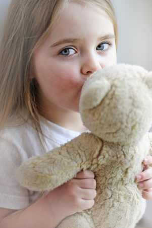 beautiful little girl with a favorite toy
