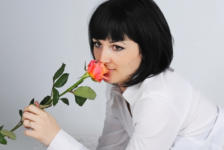 a beautiful young girl with rose