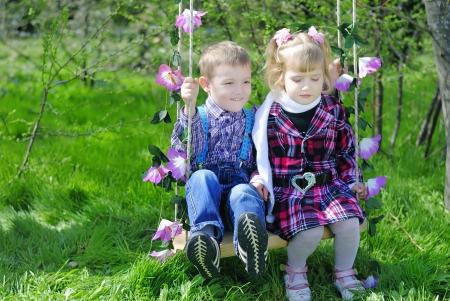 couple in love little kids on the swings photo