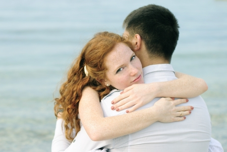 beautiful young couple in love on the beach photo
