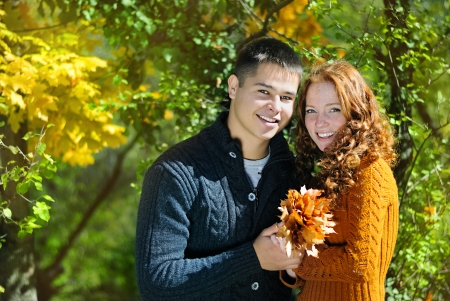 Young beautiful couple in the autumn park  Stock Photo