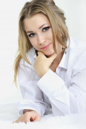 Very beautiful girl in a man's shirt photo
