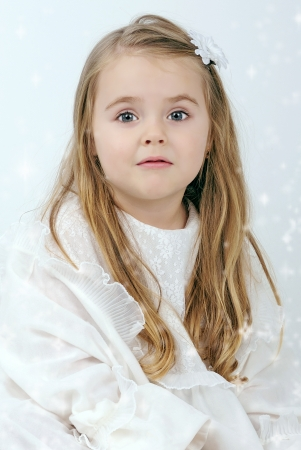 A beautiful little girl angel with a candle photo