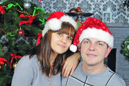 reciprocity: young couple in love near new years fir tree  Stock Photo